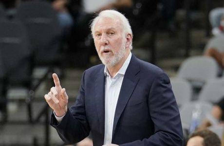 San Antonio Spurs coach Gregg Popovich signals to his players during the first half of an NBA preseason basketball game against the Detroit Pistons, Friday, Oct. 5, 2018, in San Antonio. (AP Photo/Darren Abate)