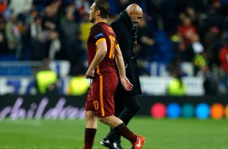 Roma's Francesco Totti and Roma coach Luciano Spalletti, right, walk on the pitch at the end of the Champions League Round of 16, second leg, soccer match between Real Madrid and Roma at the Bernabeu stadium in Madrid, Spain, Tuesday, March 8, 2016. Real Madrid won 2-0. (AP Photo/Francisco Seco)