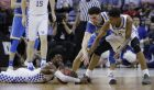Kentucky guard De'Aaron Fox grabs the ball as UCLA guard Lonzo Ball and Kentucky guard Malik Monk look on in the second half of an NCAA college basketball tournament South Regional semifinal game Friday, March 24, 2017, in Memphis, Tenn. (AP Photo/Mark Humphrey)