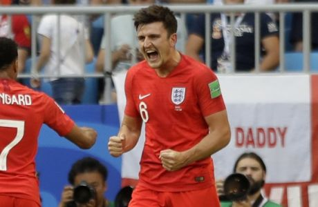 England's Harry Maguire, right, celebrates with England's Jesse Lingard after scoring his side's first goal during the quarterfinal match between Sweden and England at the 2018 soccer World Cup in the Samara Arena, in Samara, Russia, Saturday, July 7, 2018. (AP Photo/Matthias Schrader )