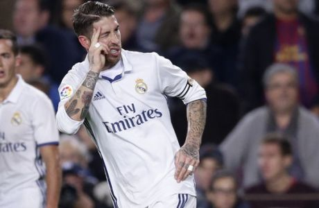 Real Madrid's Sergio Ramos celebrates after scoring his side's first goal during the Spanish La Liga soccer match between FC Barcelona and Real Madrid at the Camp Nou in Barcelona, Spain, Saturday, Dec. 3, 2016. (AP Photo/Manu Fernandez)
