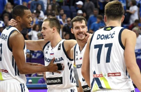 From left, Slovenia's Anthony Randolph, Klemen Prepelic, Goran Dragic and Luka Doncic celebrate their 78-72 victory against Greece in the Eurobasket European Basketball Championship qualification match in Helsinki, Finland, Sunday Sept. 3, 2017. (Jussi Nukari/Lehtikuva via AP)