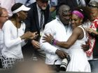 Serena Williams of the United States, right, embraces her father Richard Williams, center, as her sister Venus looks on, after she defeated Agnieszka Radwanska of Poland to win the women's final match at the All England Lawn Tennis Championships at Wimbledon, England, Saturday, July 7, 2012. (AP Photo/Alastair Grant)