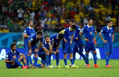 RECIFE, BRAZIL - JUNE 29:  Greece players watch a penalty shootout during the 2014 FIFA World Cup Brazil Round of 16 match between Costa Rica and Greece at Arena Pernambuco on June 29, 2014 in Recife, Brazil.  (Photo by Ryan Pierse - FIFA/FIFA via Getty Images)