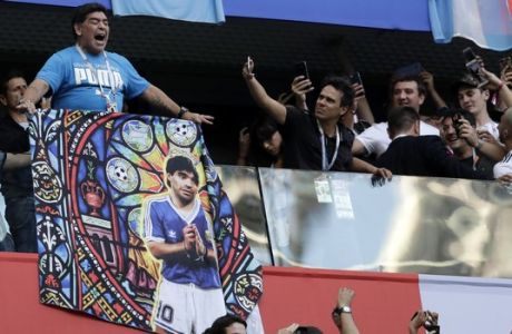 Argentina former soccer star Diego Maradona reacts as the fans take photographs ahead of the group D match between Argentina and Nigeria, at the 2018 soccer World Cup in the St. Petersburg Stadium in St. Petersburg, Russia, Tuesday, June 26, 2018. (AP Photo/Petr David Josek)