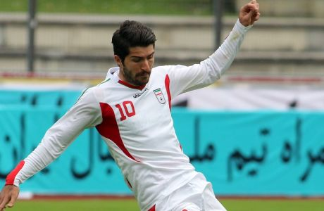 Iran's Karim Ansarifard challenges for a ball during a friendly soccer match between Iran and Belarus, in Kapfenberg, Austria, Sunday, May 18, 2014. (AP Photo/Ronald Zak)