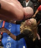 Tyson Fury, of England, kisses his wife, Paris, after his WBC heavyweight championship boxing match against Deontay Wilder, Saturday, Dec. 1, 2018, in Los Angeles. The fight ended in a draw. (AP Photo/Mark J. Terrill)