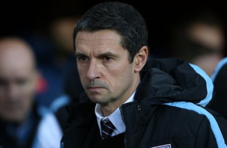 FILE - In this file photo dated Saturday, Jan. 2, 2016, Aston Villa's manager Remi Garde waits for the start of the English Premier League soccer match between Sunderland and Aston Villa at the Stadium of Light, Sunderland, England.  Garde has left the bottom-placed Premier League club left by mutual consent, after nearly five months in charge at the club. (AP Photo/Scott Heppell, FILE)