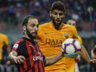 AC Milan's Gonzalo Higuain, left, and Roma's Federico Fazio go for the ball during the Serie A soccer match between AC Milan and Roma at the Milan San Siro Stadium, Italy, Friday, Aug. 31, 2018. (AP Photo/Antonio Calanni)