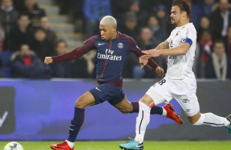PSG's Kylian Mbappe, left, challenges for the ball with Caen's captain Damien Da Silva during the French League One soccer match between Paris Saint Germain and Caen, at the Parc des Princes stadium in Paris, France, Wednesday, Dec. 20, 2017. (AP Photo/Francois Mori)