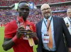IMAGE DISTRIBUTED FOR INTERNATIONAL CHAMPIONS CUP - Man of the match, Sadio Mane and Co-Founder and Chairman of Relevent Sports, Charlie Stillitano during the match between Liverpool FC and FC Barcelona, on Saturday, Aug. 6, 2016, in London. (Paul Harding/AP Images for International Champions Cup)