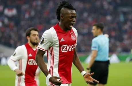Ajax's Bertrand Traore (9) celebrates after scoring the fourth goal of his team during the first leg semi final soccer match between Ajax and Olympique Lyon in the Amsterdam ArenA stadium, Netherlands, Wednesday, May 3, 2017. (AP Photo/Peter Dejong)