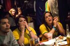 NEW YORK, NY - JUNE 12:  Brazilian soccer fans sit dejected after Crotia scores first in the Brazil vs. Crotia World Cup game at Legends Bar on June 12, 2014 in New York City. Brazil vs Crotia is the first game of the World Cup, which will take place throughout Brazil until Sunday, July 13.  (Photo by Andrew Burton/Getty Images)