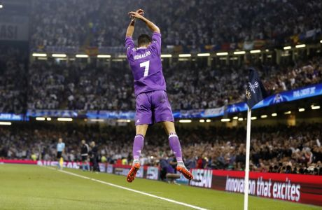 Real Madrid's Cristiano Ronaldo celebrates after scoring the opening goal during the Champions League final soccer match between Juventus and Real Madrid at the Millennium stadium in Cardiff, Wales Saturday June 3, 2017. (AP Photo/Frank Augstein)