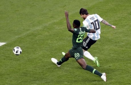 Argentina's Lionel Messi, right, scores the opening goal past Nigeria's Kenneth Omeruo during the group D match between Argentina and Nigeria, at the 2018 soccer World Cup in the St. Petersburg Stadium in St. Petersburg, Russia, Tuesday, June 26, 2018. (AP Photo/Michael Sohn)