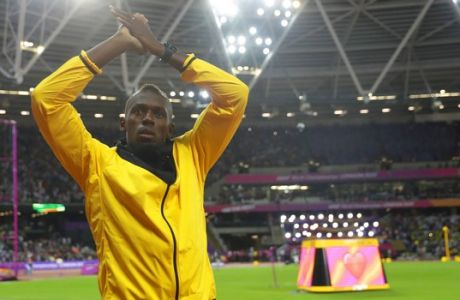 Jamaica's Usain Bolt bids farewell during a lap of honor at the end of the World Athletics Championships in London Sunday, Aug. 13, 2017. (AP Photo/Matt Dunham)