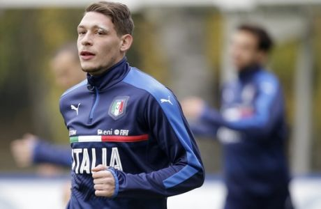 Italian soccer team player Andrea Belotti warms up during a training session in Milan, Italy, Monday, Nov. 14, 2016 ahead of a friendly soccer match between Italy and Germany scheduled for Tuesday, Nov. 15, 2016. (AP Photo/ Luca Bruno)