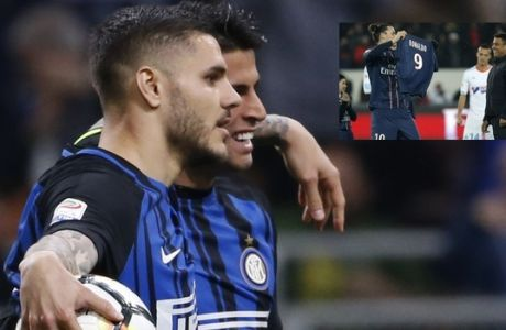 Inter Milan's Mauro Icardi, left, is embraced by teammate Joao Cancelo after scoring his side's second goal during an Italian Serie A soccer match between Inter Milan and Cagliari, at the San Siro stadium in Milan, Italy, Tuesday, April 17, 2018. (AP Photo/Antonio Calanni)