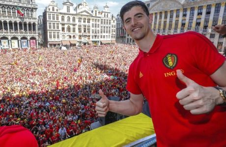 Belgian soccer team player Thibaut Courtois reacts on the balcony of the city hall at the Grand Place in Brussels, Sunday, July 15, 2018. Belgium placed third in the World Cup 2018. (Yves Herman, Pool Photo via AP)