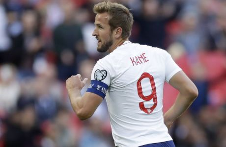 England's Harry Kane celebrates after scoring the opening goal during the Euro 2020 group A qualifying soccer match between England and Bulgaria at Wembley stadium in London, Saturday, Sept. 7, 2019. (AP Photo/Matt Dunham)