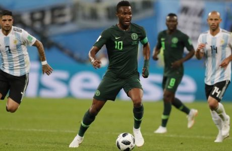 Nigeria's John Obi Mikel controls the ball during the group D match between Argentina and Nigeria, at the 2018 soccer World Cup in the St. Petersburg Stadium in St. Petersburg, Russia, Tuesday, June 26, 2018. (AP Photo/Ricardo Mazalan)