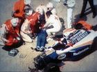 FILE- In this TV image, rescue crew members give first aid to unconscious formula one driver Ayrton Senna, lying mortally injured, beside his wrecked car after the Brazillian driver crashed against the course wall during the Grand Prix of San Marino, in this file photo dated Sunday May 1, 1994, in Imola, Italy.  The English neurosurgeon and former Formula One medical chief Sid Watkins, who tended to Ayrton Senna after his fatal crash in 1994, and is credited with saving the lives of several race drivers, has died Wednesday Sept. 12, 2012, aged 84.   Watkins was at the forefront of F1 safety for 26-years, and as a track-side doctor is credited with helping save the lives of several Grand Prix drivers after heavy crashes, but was unable to save the life of his friend Aryton Senna. (AP Photo/file)