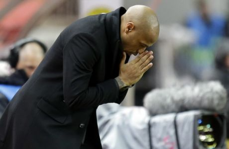 Monaco coach Thierry Henry reacts during the Champions League group A soccer match between AS Monaco and Borussia Dortmund, in Monaco, Tuesday, Dec. 11, 2018. (AP Photo/Claude Paris)