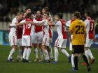 Ajax players celebrate after wining the Group E Champions League soccer match between AEK Athens and Ajax 0-2 at the Olympic Stadium in Athens, Tuesday, Nov. 27, 2018. (AP Photo/Thanassis Stavrakis)