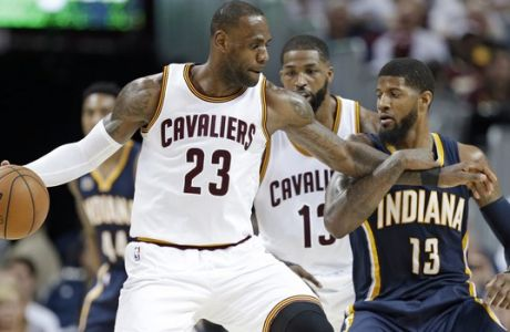 Cleveland Cavaliers' LeBron James (23) tries to drive past Indiana Pacers' Paul George (13) in the second half in Game 2 of a first-round NBA basketball playoff series, Monday, April 17, 2017, in Cleveland. The Cavaliers won 117-111. (AP Photo/Tony Dejak)