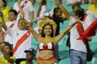 A fan from Peru's national soccer team gives a victory sign for her team prior to a 2018 World Cup qualifying soccer match against Brazil in Salvador, Brazil, Tuesday, Nov. 17, 2015. (AP Photo/Nelson Antoine)