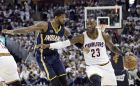 Cleveland Cavaliers' LeBron James (23) drive against Indiana Pacers' Paul George (13) in the first half in Game 2 of a first-round NBA basketball playoff series, Monday, April 17, 2017, in Cleveland. (AP Photo/Tony Dejak)