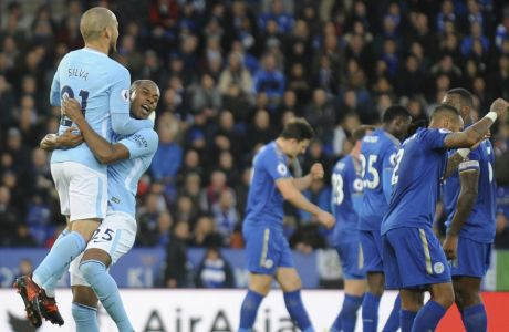 Manchester City's David Silva, left, celebrates with Manchester City's Fernandinho after Manchester City's Gabriel Jesus scored during the English Premier League soccer match between Leicester City and Manchester City at the King Power Stadium in Leicester, England, Saturday, Nov. 18, 2017. (AP Photo/Rui Vieira)
