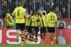 Dortmund's Pierre-Emerick Aubameyang, background right, celebrates with team mates after scoring his side's second goal during the German Soccer Cup semifinal match between FC Bayern Munich and Borussia Dortmund at the Allianz Arena stadium in Munich, Germany, Wednesday, April 26, 2017. (AP Photo/Matthias Schrader)
