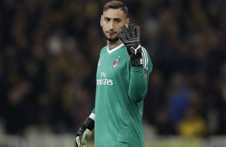 AC Milan goalkeeper Gianluigi Donnarumma gives instructions during the Europa League group D soccer match between AEK Athens and AC Milan at the Olympic stadium, in Athens, Thursday, Nov. 2, 2017. (AP Photo/Thanassis Stavrakis)
