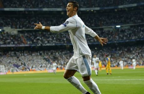 Real Madrid's Cristiano Ronaldo celebrates scoring during a Champions League group H soccer match between Real Madrid and Apoel Nicosia at the Santiago Bernabeu stadium in Madrid, Spain, Wednesday, Sept. 13, 2017. (AP Photo/Paul White)