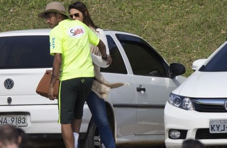 Brazil's Neymar talks with his girlfriend, the Brazilian actress Bruna Marquezine, after a practice session at the Granja Comary training center in Teresopolis, Brazil, Sunday, June 1, 2014. Brazil will travel this Sunday for the teams warm-up against Panama on Tuesday in preparation for the World Cup soccer tournament that starts on 12 June. (AP Photo/Leo Correa)
