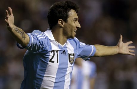 Argentina's Ignacio Scocco celebrates after scoring against Brazil during a friendly soccer match in Buenos Aires, Argentina,  Wednesday, Nov. 21, 2012. (AP Photo/Eduardo Di Baia)