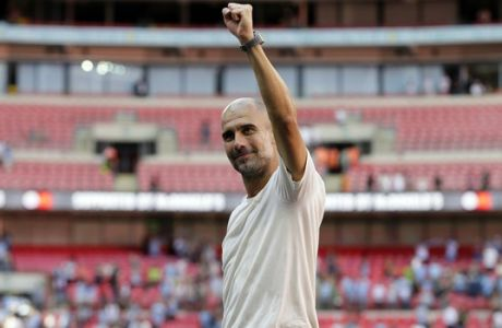 Manchester City's manager Pep Guardiola celebrates after they won the Community Shield soccer match between Chelsea and Manchester City at Wembley, London, Sunday, Aug. 5, 2018. (AP Photo/Tim Ireland)