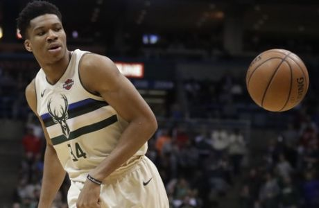 Milwaukee Bucks' Giannis Antetokounmpo looks at a ball during the first half of an NBA basketball game against the Indiana Pacers Friday, March 2, 2018, in Milwaukee. (AP Photo/Morry Gash)