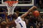 Duke's Harry Giles (1) attempts to block the shot of Pittsburgh's Michael Young (2) during the first half of an NCAA college basketball game in Durham, N.C., Saturday, Feb. 4, 2017. (AP Photo/Karl B DeBlaker)