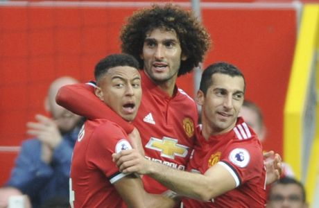 Manchester United's Henrikh Mkhitaryan, right, celebrates with Manchester United's Marouane Fellaini, centre, and Manchester United's Jesse Lingard after scoring his side second goal during the English Premier League soccer match between Manchester United and Everton at Old Trafford in Manchester, England, Sunday, Sept. 17, 2017. (AP Photo/Rui Vieira)