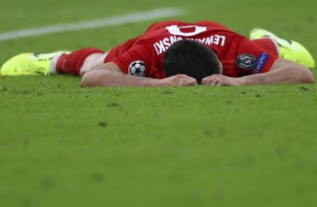 Bayern's Robert Lewandowski reacts after missing a chance to score during the Champions League group B first round soccer match between FC Bayern Munich and Red Star Belgrade, in Munich, Germany, Wednesday, Sept. 18, 2019. (AP Photo/Matthias Schrader)