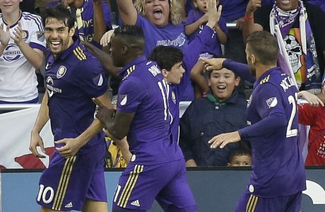 Orlando City's Kaka (10) celebrates his goal against Sporting Kansas City with teammates Carlos Rivas (11) and Antonio Nocerino, right, during the first half of an MLS soccer game Saturday, May 13, 2017, in Orlando, Fla. (AP Photo/John Raoux)