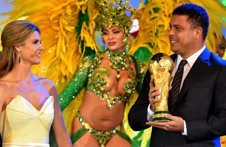 SAO PAULO, BRAZIL - JUNE 10:  Ex-Brazil international footballer Ronaldo holds the FIFA World Cup Trophy as MC Fernanda Lima looks on during the Opening Ceremony of the 64th FIFA Congress at the Transamerica Expo Center on June 10, 2014 in Sao Paulo, Brazil.  (Photo by Stuart Franklin - FIFA/FIFA via Getty Images)