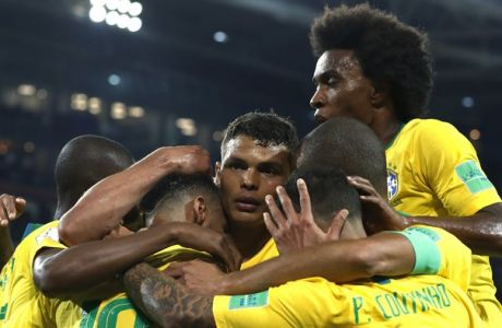 Brazil's Thiago Silva, middle, celebrates with teammates after scoring his side's second goal during the group E match between Serbia and Brazil, at the 2018 soccer World Cup in the Spartak Stadium in Moscow, Russia, Wednesday, June 27, 2018. (AP Photo/Rebecca Blackwell)