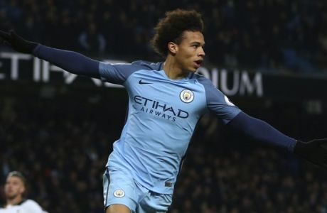 Manchester City's Leroy Sane celebrates after scoring the opening goal of the game during the English Premier League soccer match between Manchester City and Tottenham Hotspur at the Etihad stadium in Manchester, England, Saturday, Jan. 21, 2017. (AP Photo/Dave Thompson)