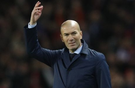 Real Madrid head coach Zinedine Zidane gestures during the Champions League round of sixteen second leg soccer match between Paris St. Germain and Real Madrid at the Parc des Princes stadium in Paris, France, Tuesday, March 6, 2018. (AP Photo/Christophe Ena)