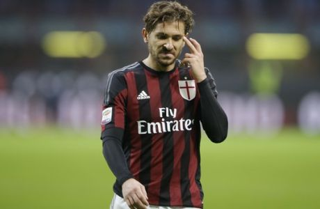 AC Milan's Alessio Cerci grimaces at the end of a Serie A soccer match between AC Milan and Bologna, at the San Siro stadium in Milan, Italy, Wednesday Jan. 6, 2016. Bologna won 1-0. (AP Photo/Luca Bruno)