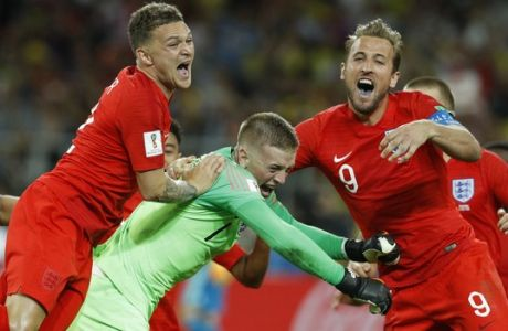 England's Harry Kane, right, goalkeeper Jordan Pickford, centre, and Kieran Trippier celebrate at the end of the round of 16 match between Colombia and England at the 2018 soccer World Cup in the Spartak Stadium, in Moscow, Russia, Tuesday, July 3, 2018. England won after a penalty shoot out. (AP Photo/Victor R. Caivano)