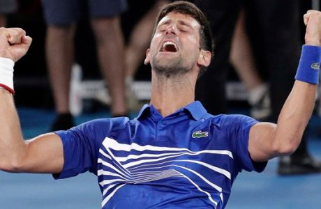 Serbia's Novak Djokovic celebrates after defeating Spain's Rafael Nadal in the men's singles final at the Australian Open tennis championships in Melbourne, Australia, Sunday, Jan. 27, 2019. (AP Photo/Aaron Favila)